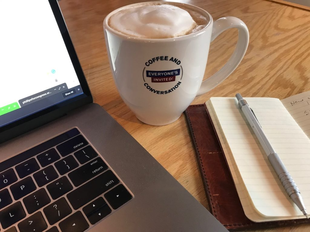 Laptop, coffee, and notebook