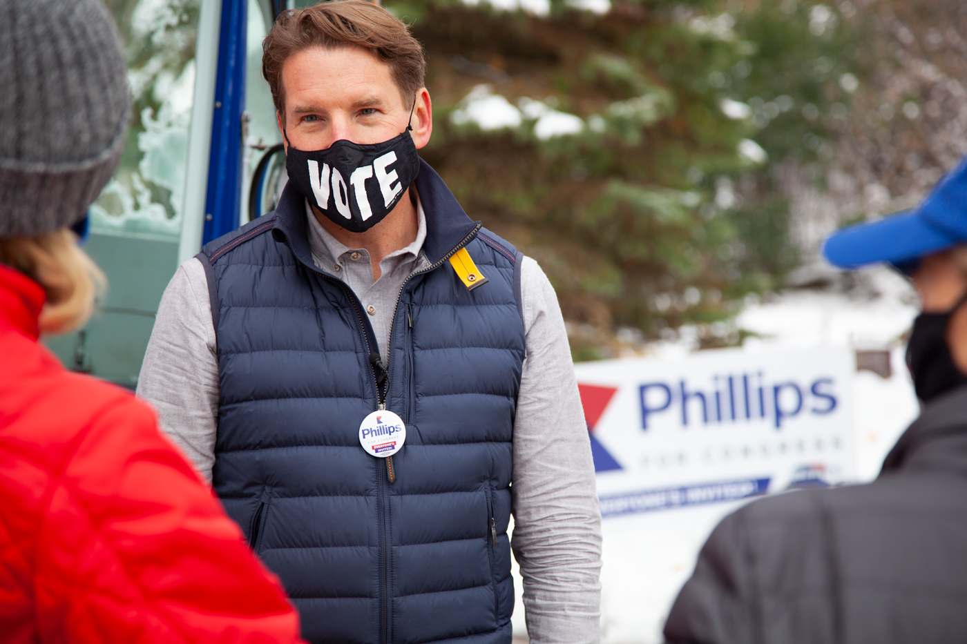 Dean Phillips wearing a VOTE mask